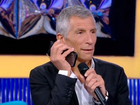 Nagui et Jean-Michel Aulas au téléphone - DR